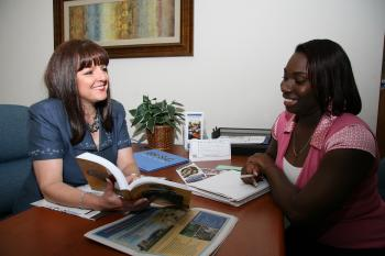 Photo of Counselor with student