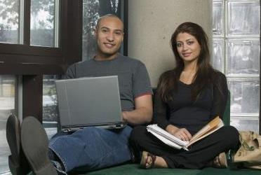 Young adult couple in library